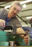 Trabalhador e braçadeiras Imagens de Stock