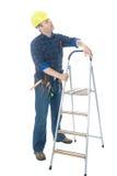 Trabalhador e escada Foto de Stock Royalty Free