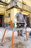 Trabalhador e máquina de estaca Imagem de Stock Royalty Free