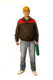 Trabalhador em um capacete de segurança amarelo com uma mala de viagem verde Foto de Stock Royalty Free