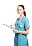 Trabalhador fêmea dos cuidados médicos que sorri a você imagem de stock