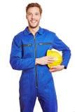 Trabalhador feliz no jumpsuit Imagem de Stock Royalty Free