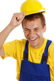 Trabalhador feliz que descola seus chapéu duro e sorriso Fotografia de Stock