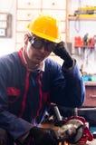 Trabalhador industrial e suas ferramentas fotografia de stock
