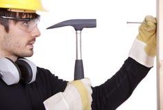 Trabalhador manual com martelo Imagens de Stock Royalty Free