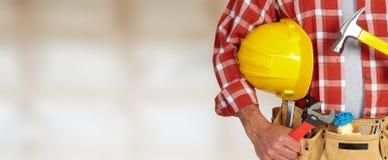 Trabalhador manual do construtor com ferramentas da construção imagem de stock royalty free