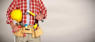Trabalhador manual do construtor com ferramentas da construção Imagens de Stock