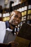 Trabalhador na loja de cópia fotos de stock royalty free