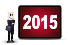 Trabalhador anônimo com números 2015 Fotografia de Stock