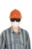 Trabalhador nos vidros, no capacete e no respirador Foto de Stock Royalty Free