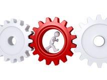 Trabalhador que corre dentro de uma roda denteada Imagens de Stock Royalty Free