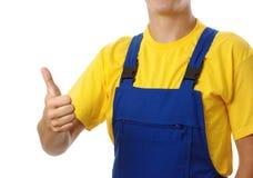 Trabalhador que mostra o polegar acima do sinal fotografia de stock