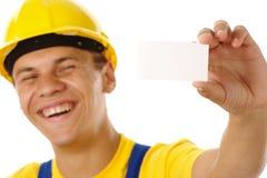 Trabalhador que mostra seus cartão e sorriso Imagens de Stock