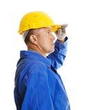 Trabalhador que olha para a frente Imagens de Stock Royalty Free