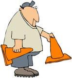 Trabalhador que põr para fora cones da segurança ilustração royalty free