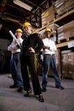 Trabalhadores com a saliência fêmea no armazém de armazenamento Imagem de Stock Royalty Free