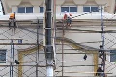 Trabalhadores da construção do andar dos sistemas de segurança Foto de Stock Royalty Free