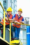 Trabalhadores da construção indonésios asiáticos Imagens de Stock Royalty Free