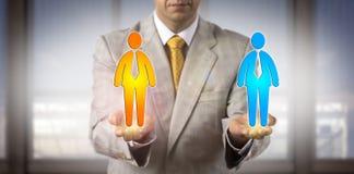 Trabalhadores de Comparing Two Male do gerente em suas mãos Foto de Stock Royalty Free