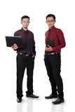 Trabalhadores de escritório masculinos eretos fotografia de stock royalty free