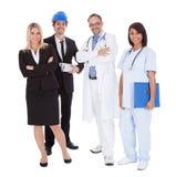 Trabalhadores de profissões diferentes junto no branco Imagens de Stock