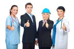 Trabalhadores diferentes que dão os polegares acima Imagens de Stock Royalty Free