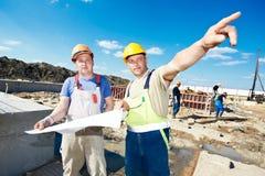Trabalhadores do construtor da construção fotografia de stock
