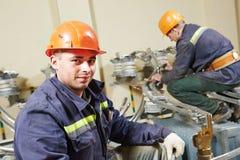 Trabalhadores dos eletricistas imagem de stock