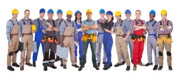 Trabalhadores manuais seguros contra o fundo branco imagens de stock royalty free