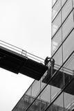 Trabalhadores na montra de vidro Imagem de Stock Royalty Free