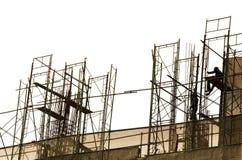 Trabalhadores no fundo da construção Imagem de Stock Royalty Free
