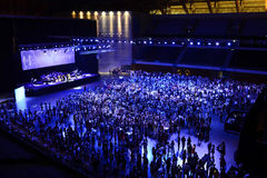 Trabalhadores no partido e no concerto incorporados, trabalhos de equipa Foto de Stock Royalty Free