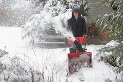 Trabalhando com pá a neve Foto de Stock Royalty Free