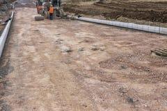 Trabalho no local da construção de estradas Fotografia de Stock