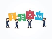 Trabalhos de equipa com conceito do enigma Imagens de Stock