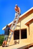 Trabalhos de equipa da construção foto de stock