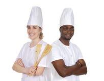 Trabalhos de equipa da cozinha Fotos de Stock
