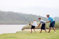 Trabalhos de equipa da pesca Foto de Stock
