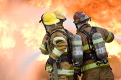 Trabalhos de equipa do sapador-bombeiro Foto de Stock