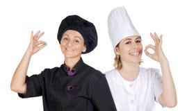 Trabalhos de equipa dos cozinheiros chefe Fotografia de Stock Royalty Free