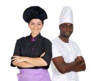 Trabalhos de equipa dos cozinheiros chefe Foto de Stock