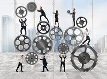 Trabalhos de equipa dos empresários foto de stock