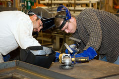 Trabalhos de equipa dos soldadores Fotos de Stock Royalty Free