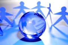 Trabalhos de equipa globais Imagens de Stock