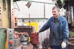 Trabalhos do operador de máquina da trituração Imagens de Stock