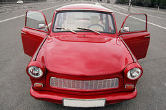 Trabant. Shiny red old Trabant car with open doors on a highway Stock Photo