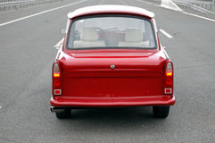 Trabant on a highway. Red Trabant car on a highway Royalty Free Stock Photos