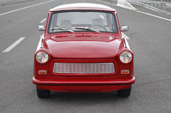 Trabant on a highway. Red Trabant car on a highway Stock Photo