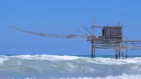 Trabocchi coast in Abruzzo with big waves on rough sea - Italy - Trabucchi are old fishing machines famous in south stock footage
