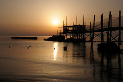 Trabocco into the sunset. Equipment for fishermen to the dawn Abruzzese Royalty Free Stock Photos